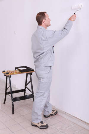 odd jobs: tradesperson painting Stock Photo