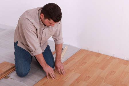 Man laying a wooden floor Stock fotó