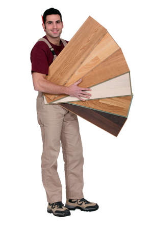 Carpenter with an assortment of flooring Stock Photo - 12007852