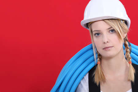 Young woman plumber photo