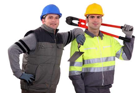 journeyman technician: Two handyman. Stock Photo