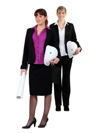 two businesswomen on a construction site photo