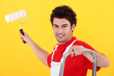 A painter holding a paint roller photo