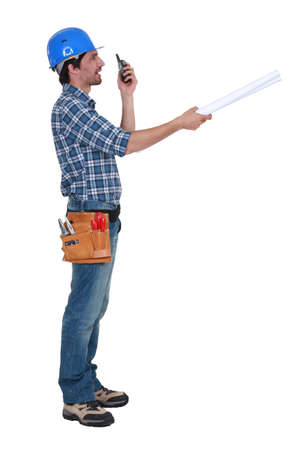 two way: Tradesman trying to communicate with his colleague from a distance
