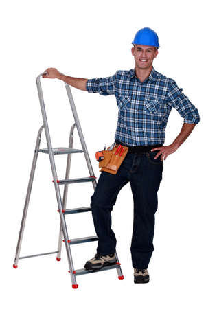 Handyman with step-ladder on white background photo