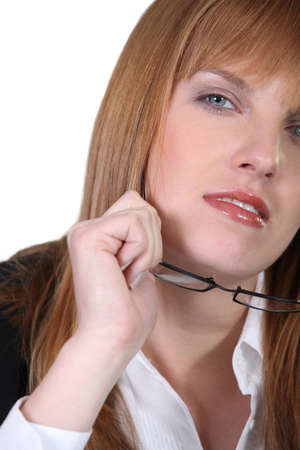 cagey: woman taking off reading glasses