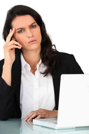 Businesswoman with laptop at a desk Stock Photo - 12008045