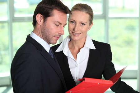 Businessman looking at paperwork. Stock Photo - 12008055