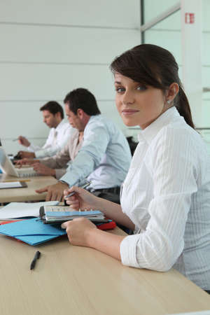 Woman writing in her agenda photo