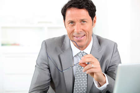 45 55 years: Businessman smiling Stock Photo