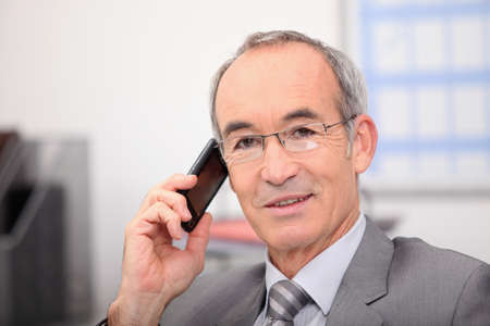important phone call: Man talking on the phone