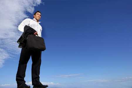brief case: Businessman lost outdoors Stock Photo