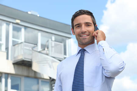 property management: Businessman on mobile telephone