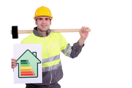 energy ranking: Construction worker with an energy rating card