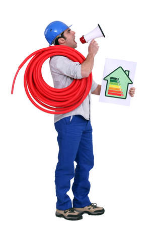 Man with a loudspeaker and household energy rating sign photo