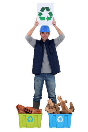 Young tradesman promoting recycling photo