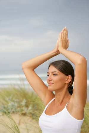 Woman doing yoga in the dunes photo