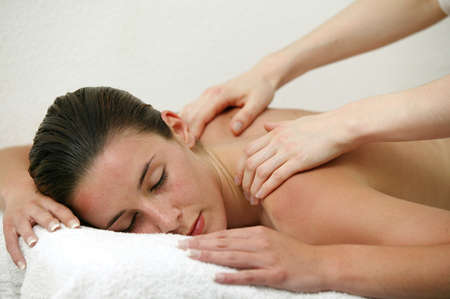 Woman enjoying shoulder massage Stock Photo - 12007826
