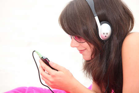 portrait of a young woman listening to music photo