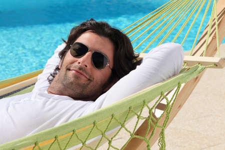undisturbed: Man relaxing in hammock Stock Photo