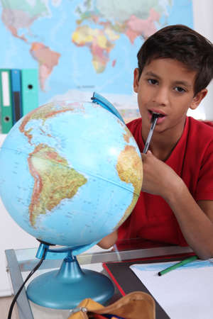 Little boy in classroom, looking bored photo