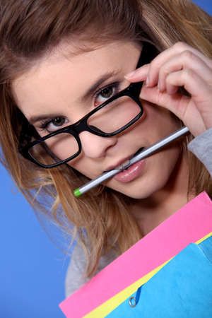 wearer: Girl with a pencil in her mouth