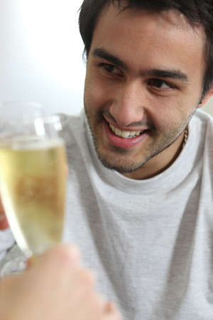 Man drinking champagne photo