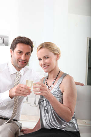 Couple celebrating with a glass of champagne photo
