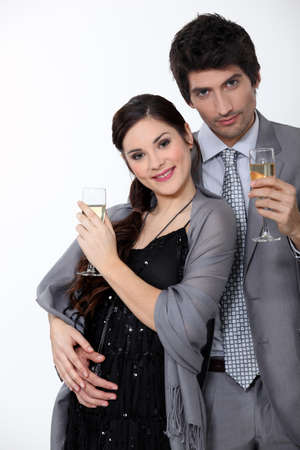 formal wear clothing: Glamorous couple drinking champagne Stock Photo