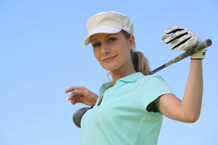 golf glove: portrait of a woman in golf clothes Stock Photo