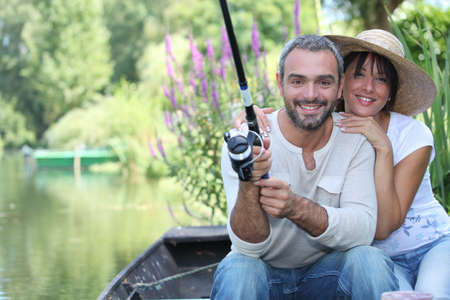 Romantic couple fishing on the river photo