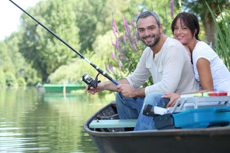 Couple in row boat fishing photo