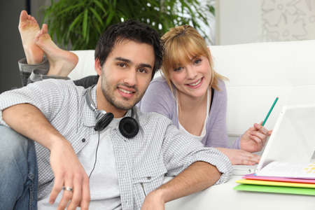 Couple at home with laptop and headphones photo