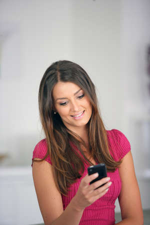 answering: Woman sending a text message Stock Photo