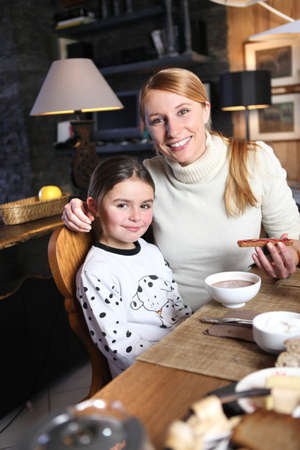 Mother and daughter eating breakfast together Stock Photo - 12068800