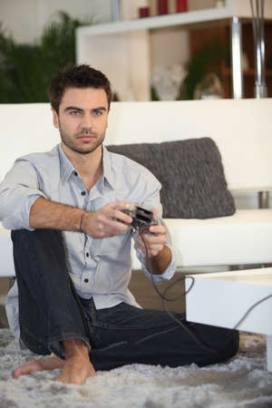 captivate: Man playing on console Stock Photo