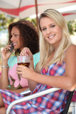Young women sitting in a cafe Stock Photo - 12103711