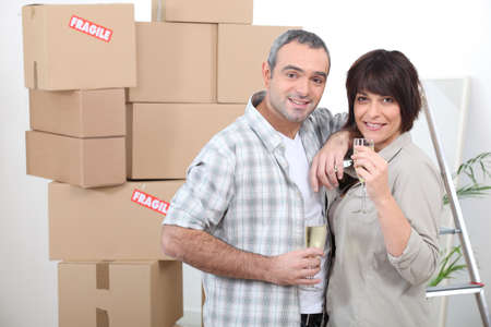 Couple celebrating moving in with champagne photo