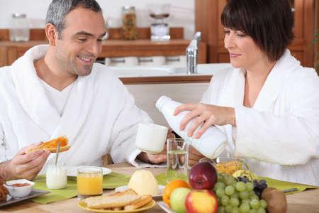 eating yogurt: Couple having breakfast together