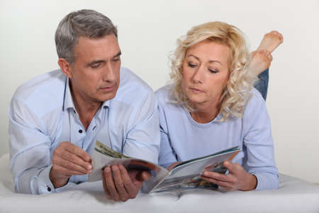 Mature couple lying in bed Stock Photo - 12006490