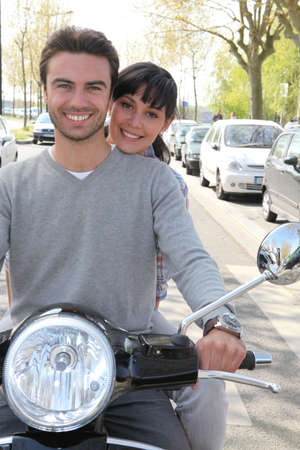 Couple on scooter photo