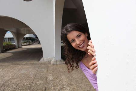 Woman playing peekaboo photo
