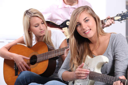 Teenagers playing the guitar photo