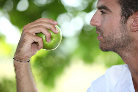 close-up of a man with an apple photo