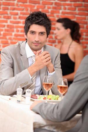the well groomed: Men eating in a restaurant