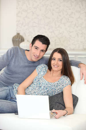 Couple shopping online photo