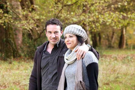 Couple walking through park in autumn photo