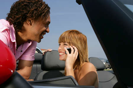 Couple by convertible car photo