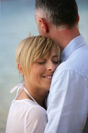 blissfully: couple by seashore Stock Photo