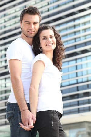 Couple stood by large office building Stock Photo - 12006493